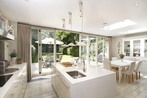 kitchen bi-fold doors. Nice wide island with sink so one can face out - would it get messy?