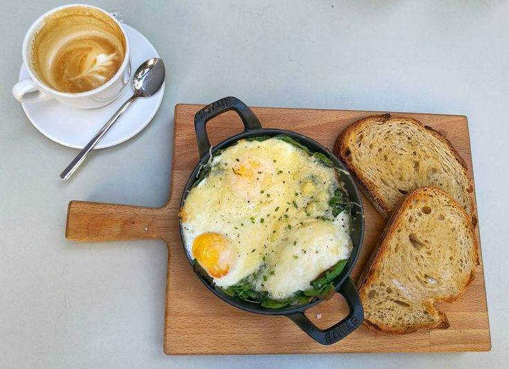 Baked eggs with spinach and parmesan with a flat white at Federal Cafe Barcelona Gotic