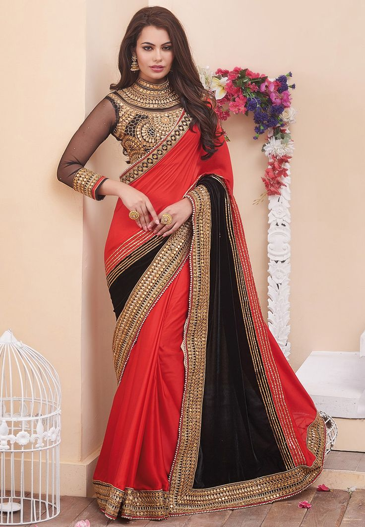 Buy Embroidered Crepe and Velvet Saree in Red and Black online, work: Embroidered, color: Black / Red, usage: Wedding, category: Sarees, fabric: Crepe, price: $170.72, item code: STN2001, gender: women, brand: Utsav