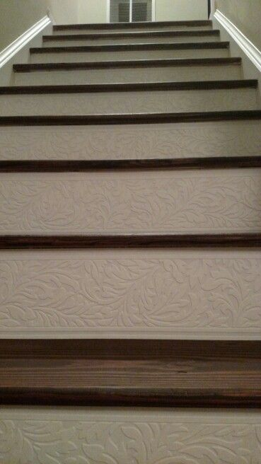 Carpet to wood stairs! Spring Break 2015! Used paintable wallpaper border on the risers.