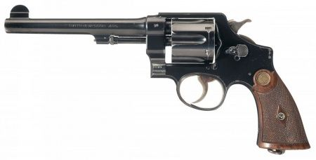 The second Smith & Wesson revolver used onscreen is a British-issue Mk II Hand Ejector Model, again with shortened barrel, as loaned out by the Bapty company. This gun was used in the Ravenwood bar shootout (filmed at Elstree Studios, England), and Cairo, Egypt street scenes (filmed in Tunisia), where it was fired several times. Jones uses it famously to clear his path when confronted by a giant, menacing Arabian swordsman (Terry Richards).
