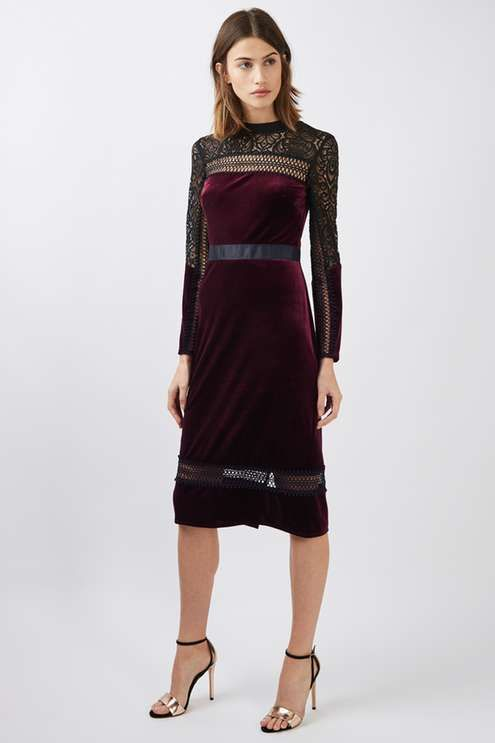 Lend a luxe feel to your partywear in this mixed mini dress. In a deep berry red velvet finish, it features pretty black lace trim detail and mesh cut outs. Compliment the look with heeled sandals and a statement clutch. #Topshop