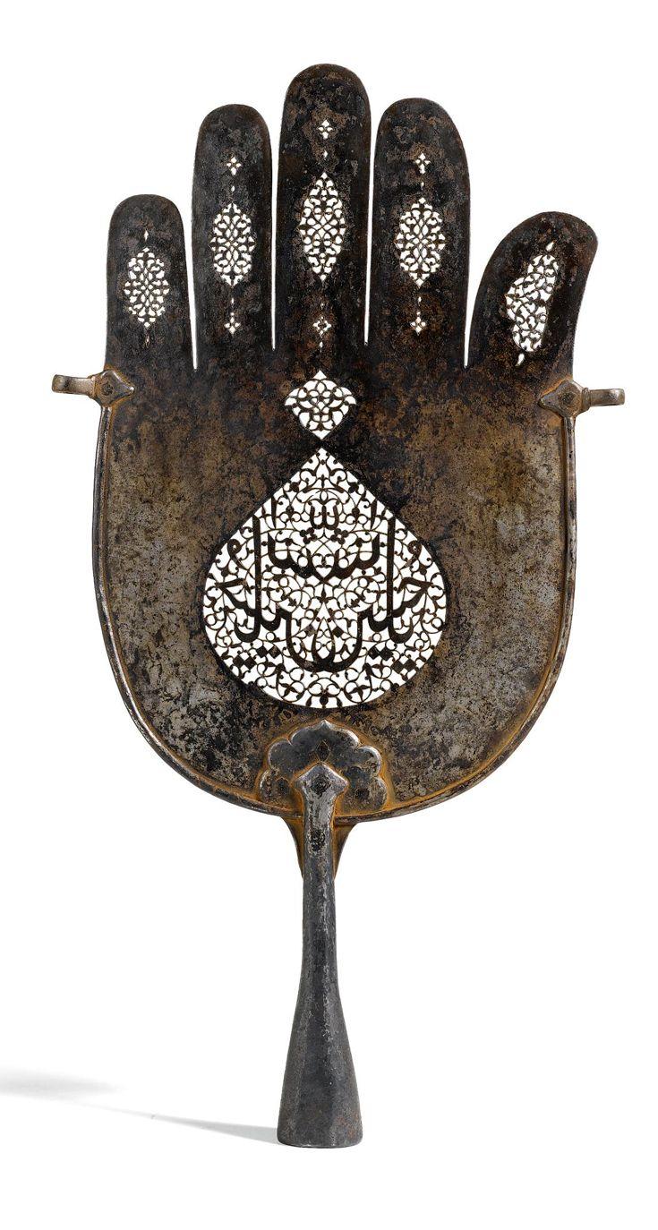 A calligraphic pierced steel 'Hand of Fatima'. Persia, Qajar, ca. 1800