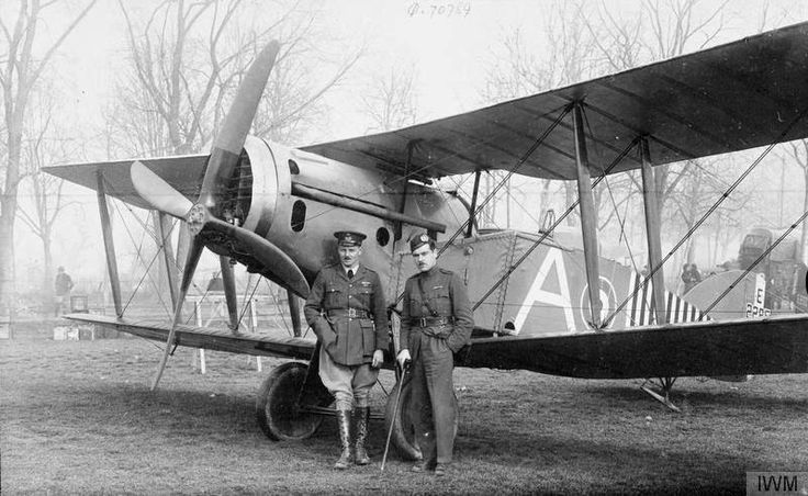"""IWM caption: """"Captains Hursthouse and Wilson of No. 28 Squadron RAF by a Bristol F.2B fighter biplane, Florence."""" Source: IWM (Q 70789)"""