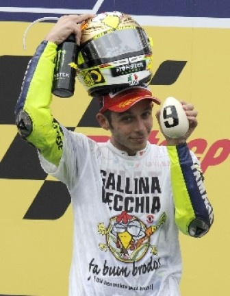 Valentino Rossi celebrated his 9th World Championship title on the warm down lap with his fan club's usual celebration t-shirt & new helmet designed by Aldo Drudi.