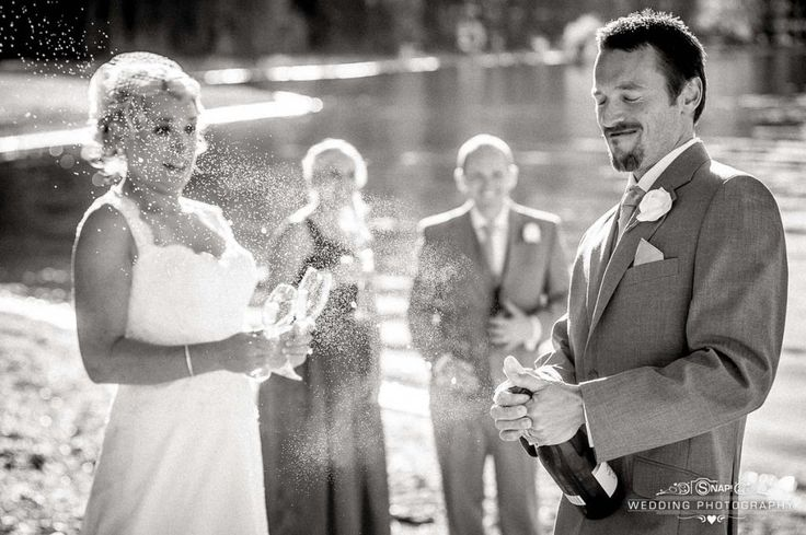 Champagne pop!  More wedding photography by Anthony Turnham at www.snapweddingphotography.co.nz