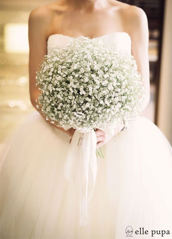 Classic white baby's breath wedding bouquet. I like this but maybe not quite so much baby's breath packed in.