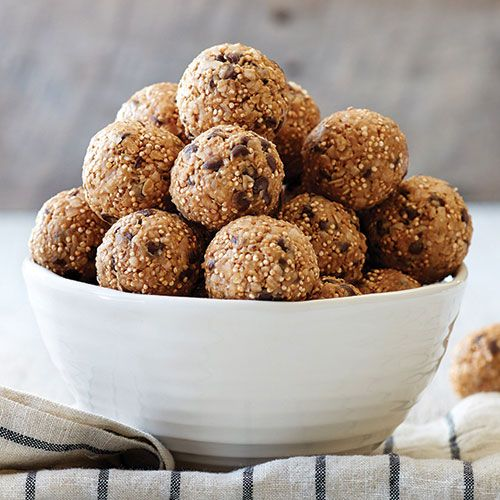 Toasted Quinoa Energy Bites Recipe Desserts, Lunch, Snacks with quinoa, quick oats, sweetened coconut flakes, semi-sweet chocolate morsels, creamy peanut butter, honey