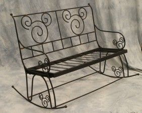 Wrought iron rocking bench with Mickey Mouse design