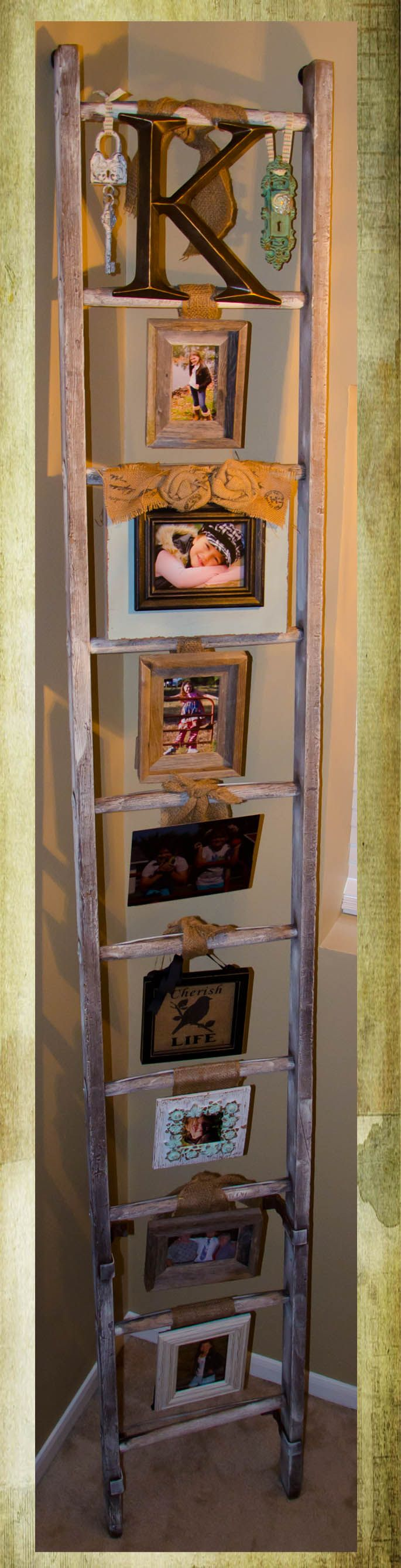 Old ladder repurposed as a photo display!