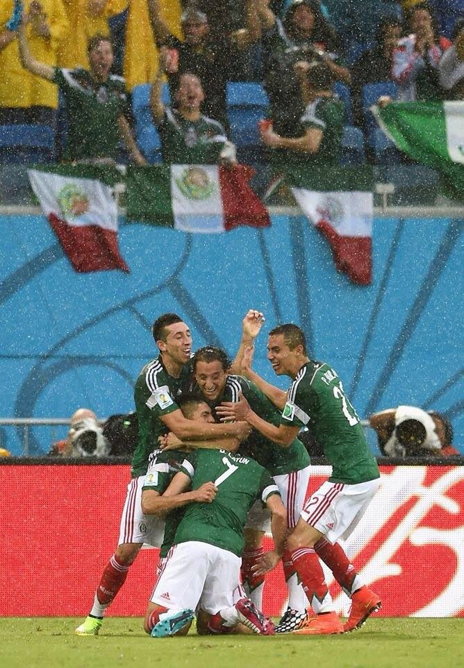 1494be4d6 ORIBE PERALTA MEXICOAMERICA SIGNED AWAY AMERICA JERSEY WCAMPEON 2014 INSCR  PSA Oribe Peralta of Mexico celebrates his goal with teammates in the  second half ...