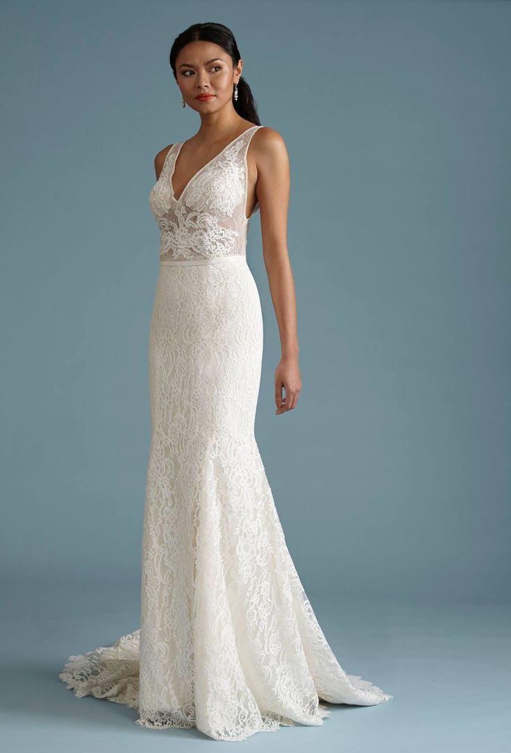 Barbra Allin 8063 - This V-neck fitted gown has a sheer appliqued bodice and is made in house in our Toronto Studio. http://beckersbridals.com/