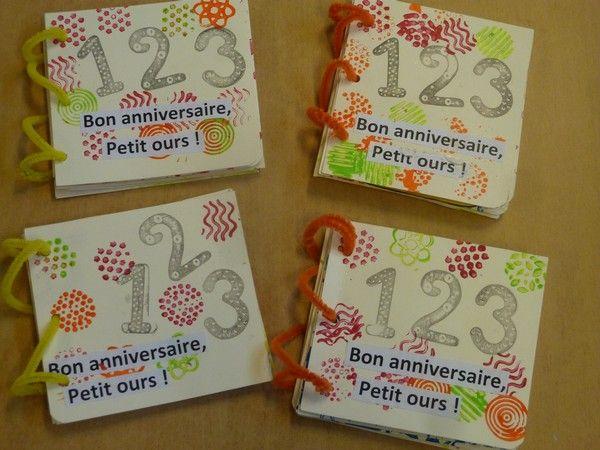 """livre à compter """"bon anniversaire petit ours"""" avec trous pour passer les doigts et représenter les bougies"""
