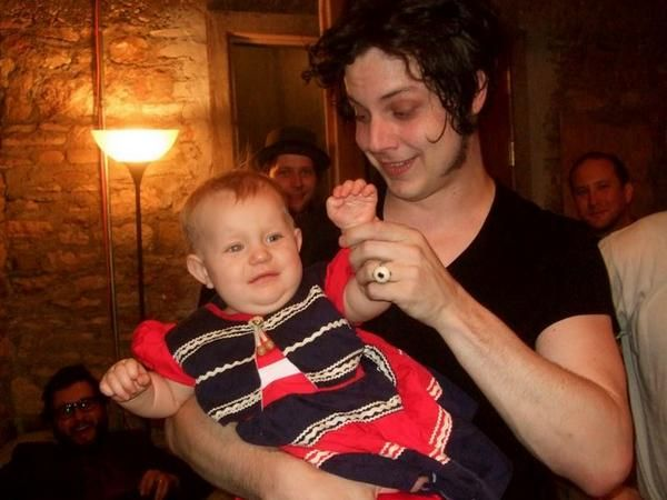 Jack playing with fan's baby.