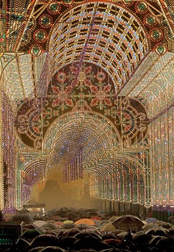 "Valencia, Spain  ""Hundreds of people stand under spectacular lighting on the Literato Azorin as Valencians honour their patron saint, Saint Joseph"""