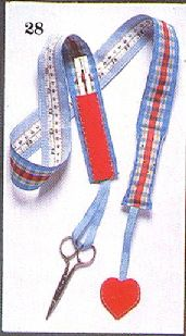 Neck Caddy made from material  and ribbon  ....has a tape measure and pin cushion, holds seam ripper etc .