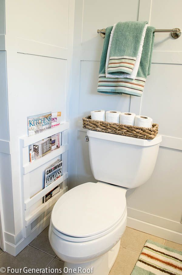 I am so not a fan of magazines sitting next to the potty, but aside from that, this is a clever way to blend a shelf for them right onto the wall.......D.