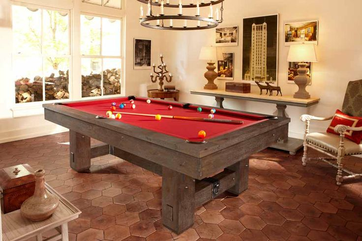 The Brunswick Merrimack pool table is a classic design featuring hand-hammered metal hardware and distinctive artisan joinery - the ideal complement to a handsome, hand-rubbed antique finish that showcases the natural knots, grain and texture of the table's rough-hewn wood. The Merrimack is a striking example of Old World Craftsmanship. As with all Brunswick pool tables the precision, stability and playability you've come to expect is present.
