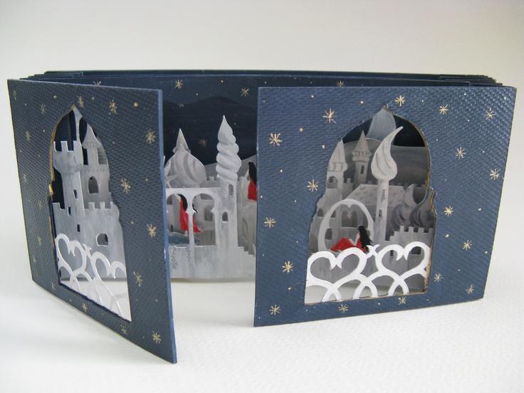 "Insomnia Dream by Patricia Sarrafian Ward. Tunnel book.  2007.  6 7/8"" x 3 3/16"" x 7/8"".  Casing:  Book board, acrylic paint.  Book:  Book board, paper, acrylic paint."