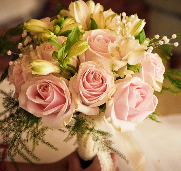 Hand-tied bridal bouquet of Sweet Avalanche Roses, Alstromeria, Asparagus Fern and pearls. filler options: asparagus ferns  pearls!