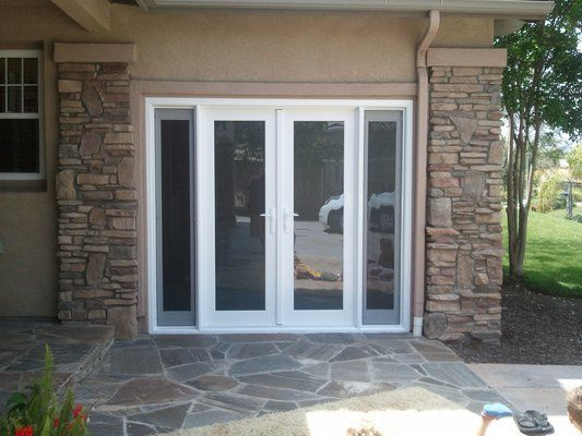 Garage Door Converted Into French Door With Two Side Lights That Open.