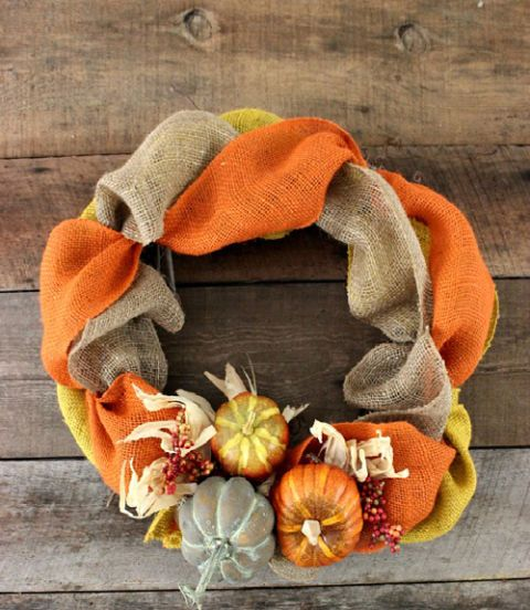 This braided burlap wreath, which can be hung on either a front door or mantel, can be hung from late September straight through to November.  Get the tutorial at Hoosier Homemade.