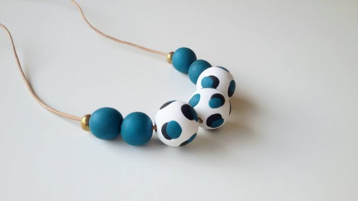 A personal favourite from my Etsy shop https://www.etsy.com/au/listing/288707927/teal-dots-statement-necklace-winter