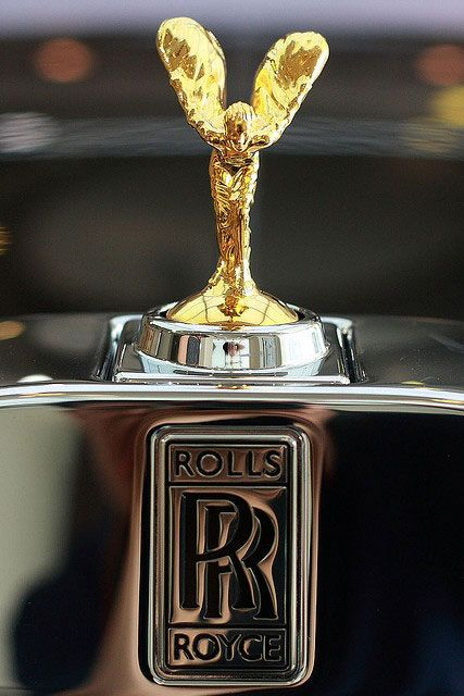 RR  LOGO : ROLLS ROYCE :  Named after Lord Charles Stewart Rolls and Sir Frederick Henry Royce. History : https://en.wikipedia.org/wiki/Rolls-Royce_Limited  https://en.wikipedia.org/wiki/Rolls-Royce_Motor_Cars