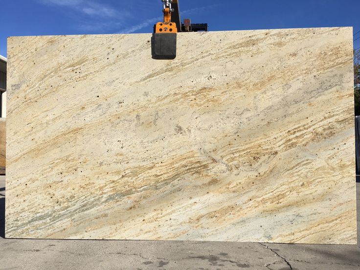 #IvoryGold #granite is low variation #naturalstone with shades of beige, gold, white and yellow. A perfect #granitecountertops slab for light or dark #kitchencabinet or #kitchenisland.