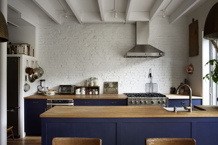 """Vardi planned her blue kitchen """"years before it became a thing"""" (see Trend Alert: The Cult of the Blue Kitchen). and says she's never tired of it. She also had been set on marble counters, but Weeks pointed out that they'd """"make the whole room feel like a kitchen."""" Instead, they went with oak finished with food-safe Rubio Monocoat. """"We were advised against wood counters and, in truth, they look good but have been hard to maintain: wood warps and stains. Butcher block might have been better…"""