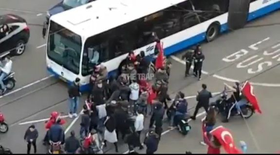 The Turks in the Netherlands started rioting after the Dutch government decided to block Turkey's foreign minister from entering the Turkish consulate in Rotterdam. They are now blocking traffic and terrorizing passengers on a bus.