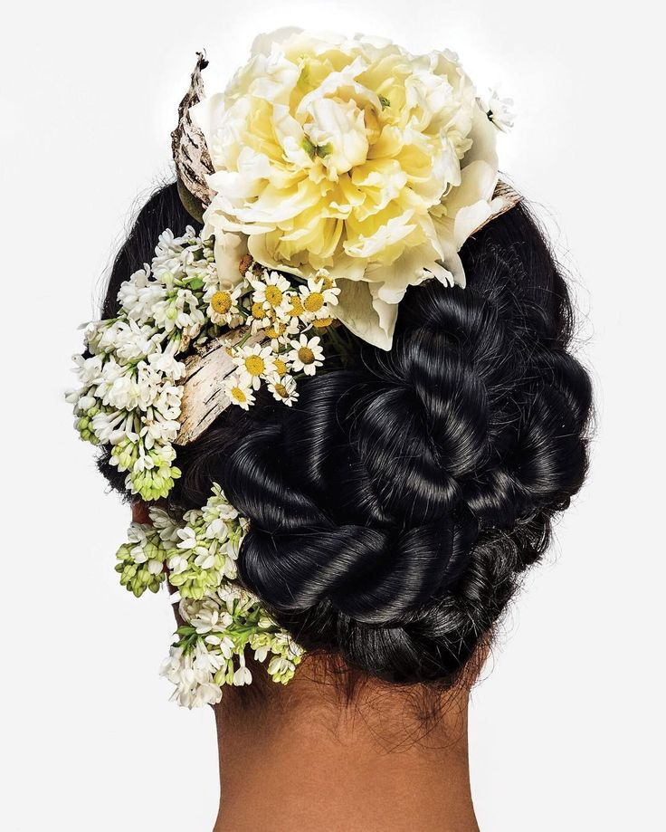 It is possible to wear flowers in your hair on your wedding day and not look like you're off to Coachella and in the Spring/Summer 2016 issue of #nymagweddings we show you how. Here a knotted updo with lilacs and peonies by hairstylist Gareth Bromell of the @marierobinsonsalon. To see more styles click the link in our bio. : #BobbyDoherty by nymag