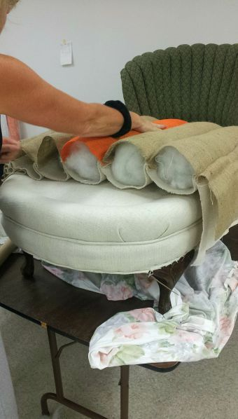 We got a lot done during week 4 of our upholstery class. Janice attached the striped fabric panel on thebottom of her chair and positioned her buttons along the back. Karen got the channeling fo…