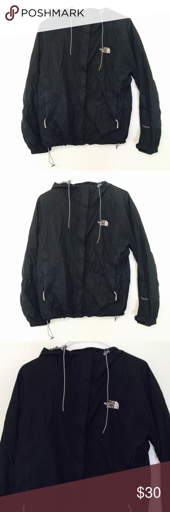 The North Face Black Wind Breaker Jacket! Size large! Interior is crackaling but the exterior is in excellent condition! North Face Jackets & Coats