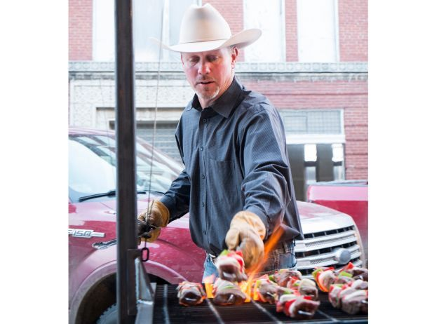 Ladd grilling steak kebabs for the Cowboy Christmas Party 2014