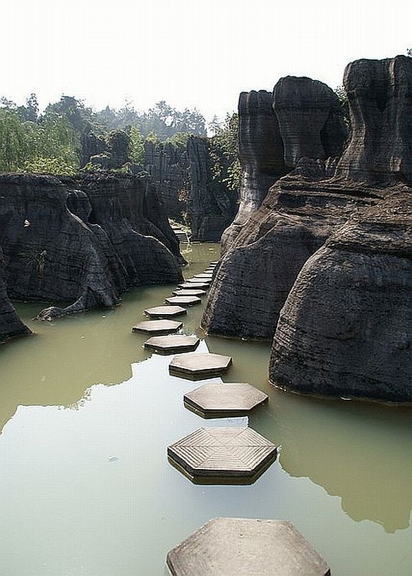 Emmy DE * Wansheng Stone Forest, China was formed between 460 million to 600 million years ago and predates Lunan Stone Forest in Yunnan province by about 200 million years