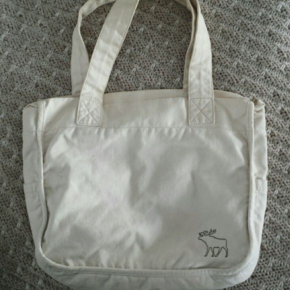 Abercrombie and Fitch small tote bag Barely used small tote bag from Abercrombie and Fitch with 2 outside side pockets, flannel inside and mouse logo on front Abercrombie & Fitch Bags Totes