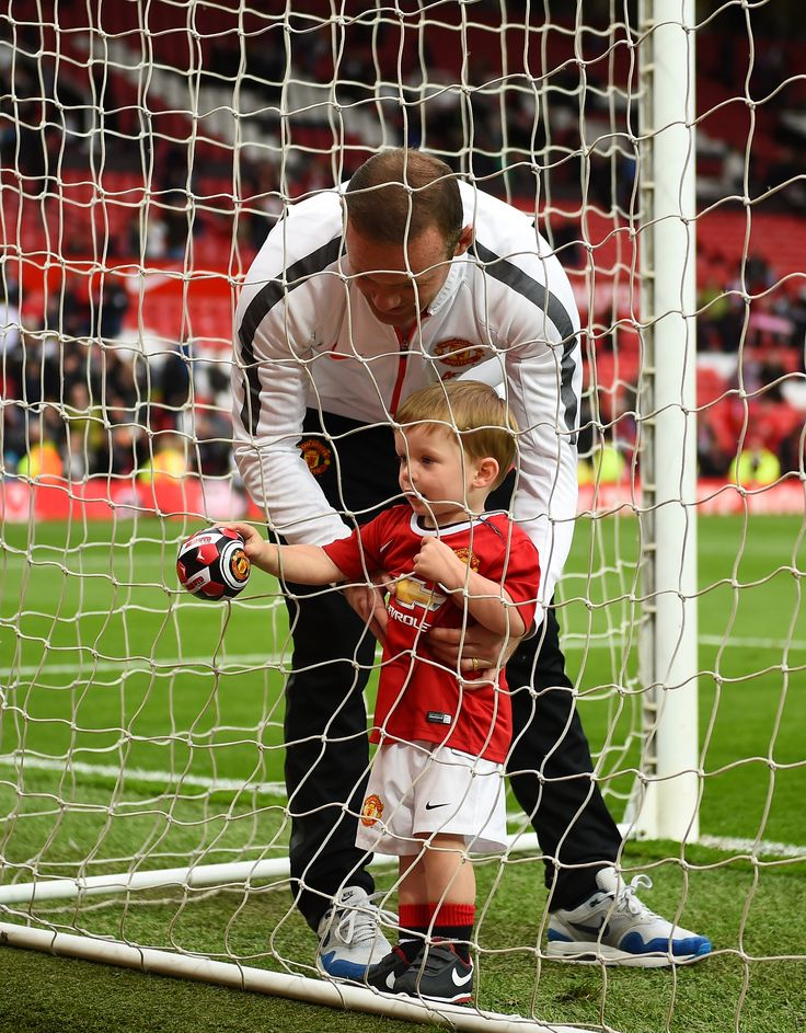 @manutd's Wayne Rooney joins his youngest son for a kickabout on the Old Trafford pitch.