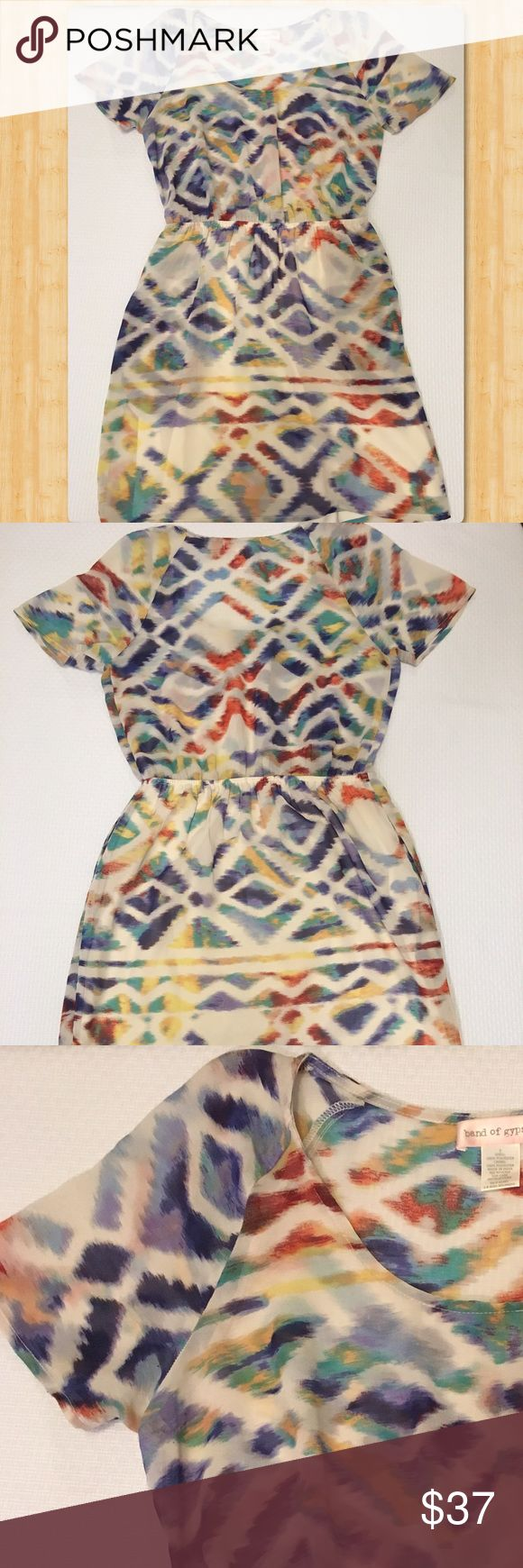 Multi color Band of Gypsies short sleeve dress Gorgeous multi color short sleeve band of gypsies dress.  The bottom is lined and the top is unlined so it's semi-sheer.  Elastic waist for comfortable fit. Band of Gypsies Dresses