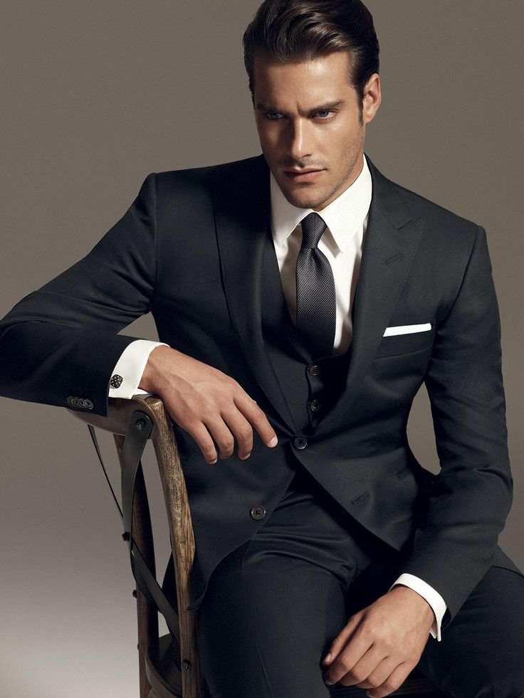 Classic black suit, with vest. Pair it with a crisp white shirt and charcoal tie and you are set for any occasion. You will also compliment any outfit your partner dons.