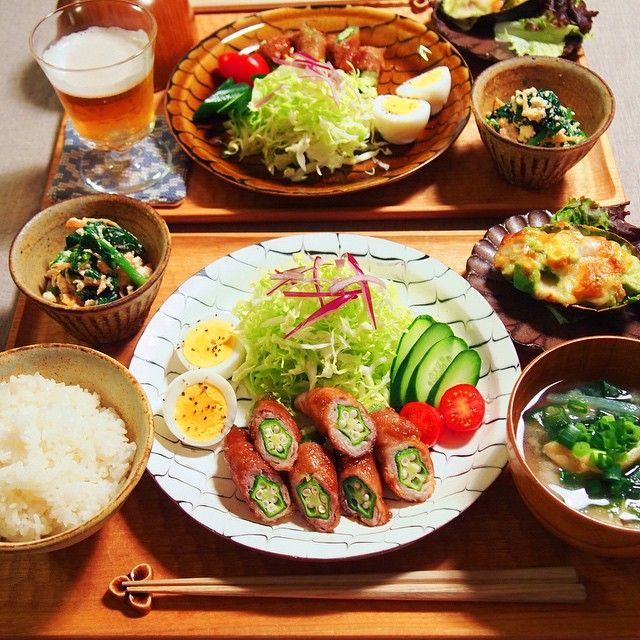Some bacon-wrapped okra, cabbage salad, hard-boiled egg, a stuffed bell pepper, miso soup, and I think some miso spinach (or maybe spinach and chicken) in the top left