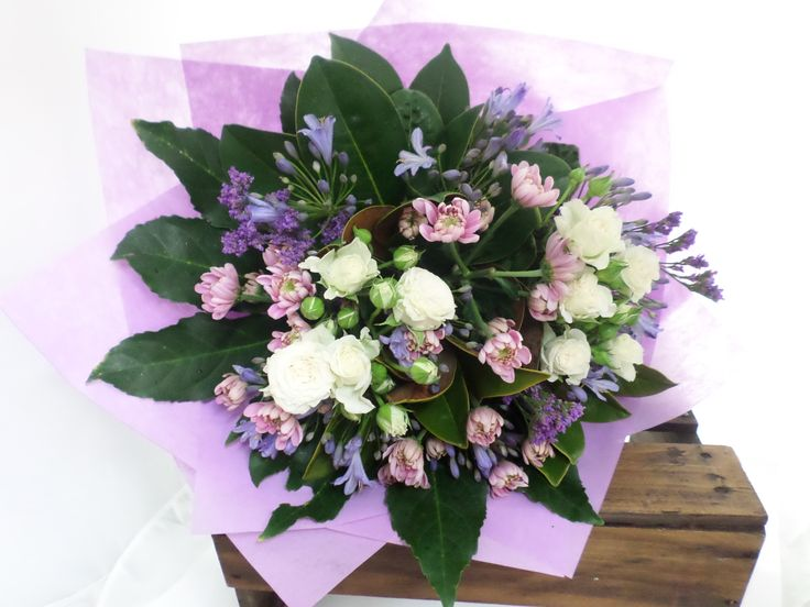 Gorgeous bouquet with pinks and mauves. Created by Florist ilene