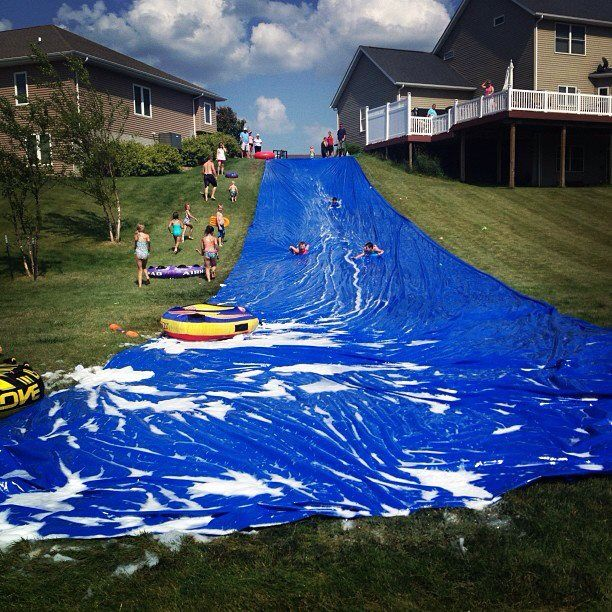 Giant Slip and Slide: Our most epic 4th of July homemade slip-n-slide! Made with boat shrink wrap (can buy online) and Dawn dish soap. It was awesome!