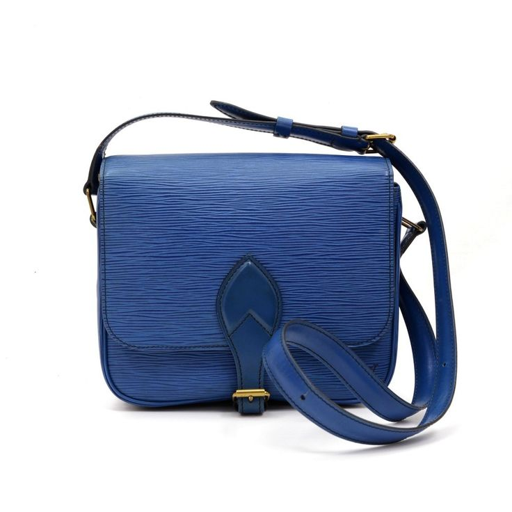 Authentic Louis Vuitton Cartouchiere MM in blue epi leather. Flap top secured with belt closure. Inside is leather lining. Comfortably carry on shoulder or across body with adjustable leather strap. #LouisVuitton #Handbag @fmasarovic