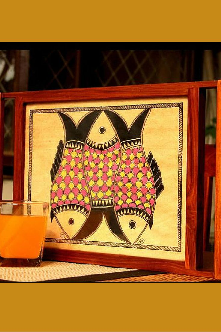 The fish motifs on this tray perfectly represent the soul of Madhubani art work. Madhubani art is native to Bihar. The dull overtones of pink and yellow against black make this tray extremely pleasing to the eyes. It is crafted out of teak wood and should be a part of the collection of every Madhubani art lover.