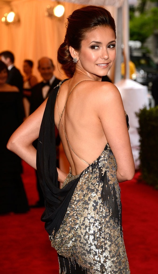 Low back black and gold sequin gown on Nina Dobrev