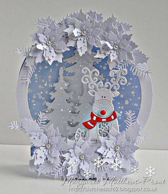 Tattered Lace snow globe....
