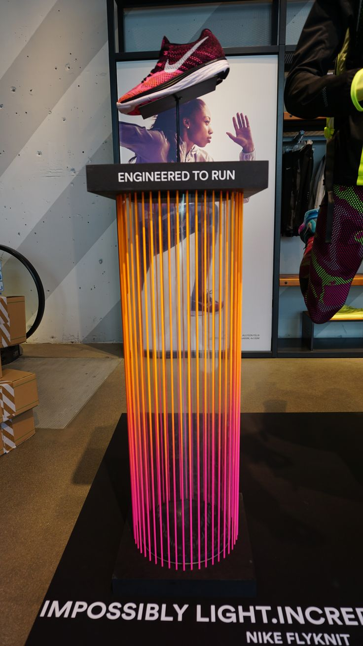 Showcasing the new item in the display feels premium.   Background: Nike display: production www.confettireclame.nl