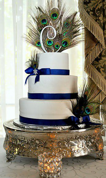 Peacock cake- the feather might look pretty with the navy and silver theme - in centerpieces or bouquets?