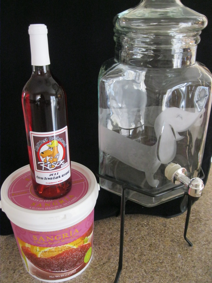 This is a one of a kind raffle item at Midwest Dachshund Rescues fundraiser May 18th.  It's a large drink dispenser with a dachshund etched into the glass, includes sangria mix and Midwest Dachshund Rescue labeled wine.  For more info go to their facebook page:  https://www.facebook.com/MidWesDacRes